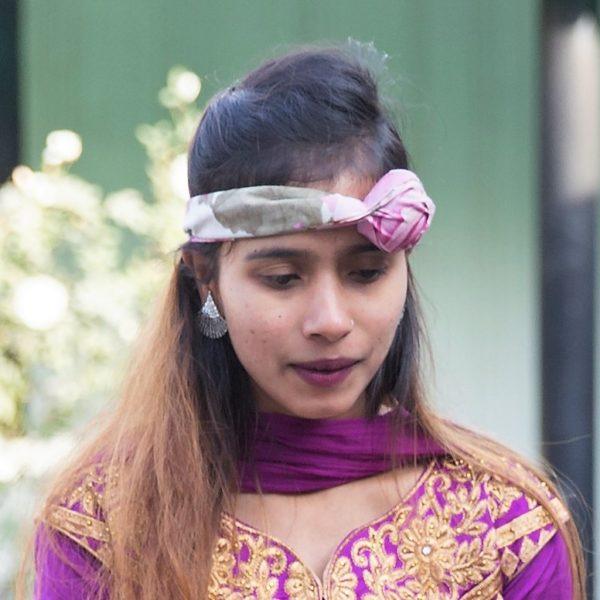 Sristi wearing purple forehead jewelry