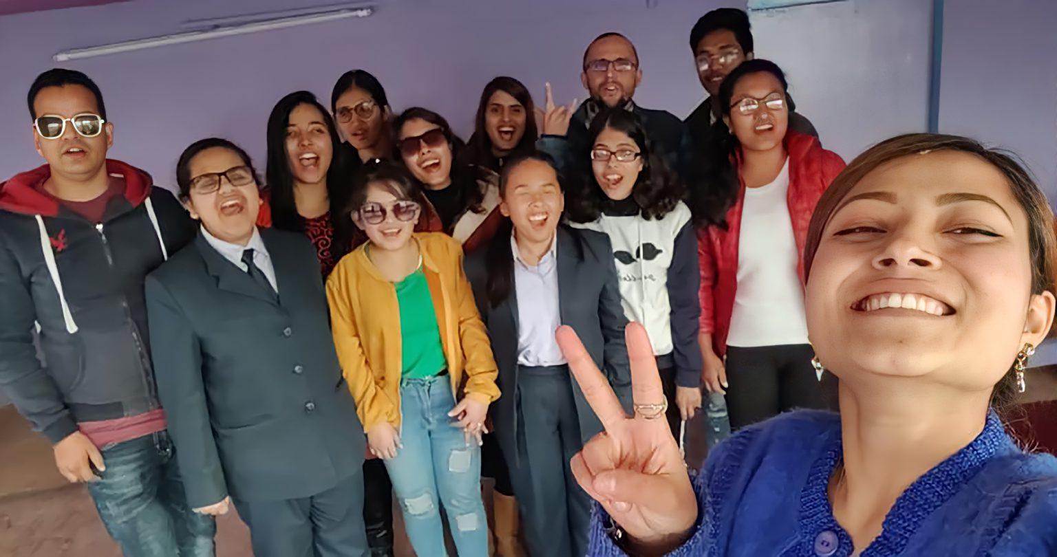 Blind Rocks! staff Divya Shah capturing selfie with beneficiaries and Sristi cheering behind Divya