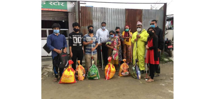 Group Photo of Relief Food Package Distribution campaign.